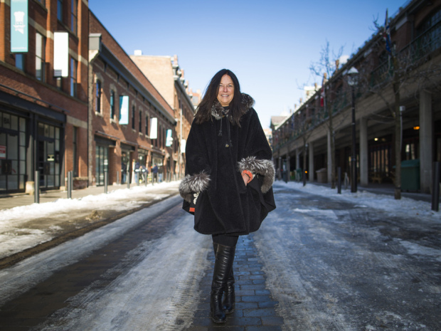 Eve Lewis, owner of Woodcliffe Landmark Properties, is seen here along Market Street in downtown Toronto, Ontario, Monday Feb. 3, 2014, which is undergoing a dramatic transformation.